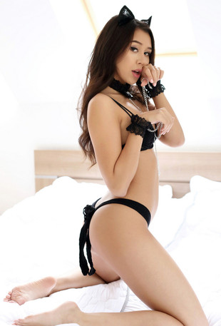 Sexy asian kitty playing with some toys.