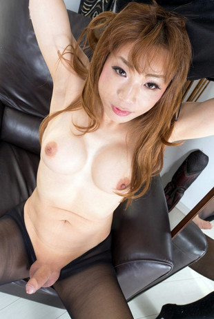Busty oriental shemale takes off her..