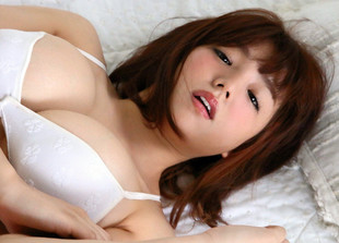 Busty asian model Ai Shinozaki posing..