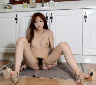 Redhead Korean babe with nice bush..
