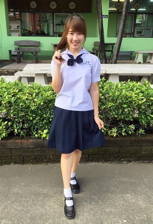 Oriental schoolgirl with a charming..